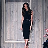 Victoria in a double-belted shift and chunky platform pumps at her own Fall 2012 show.