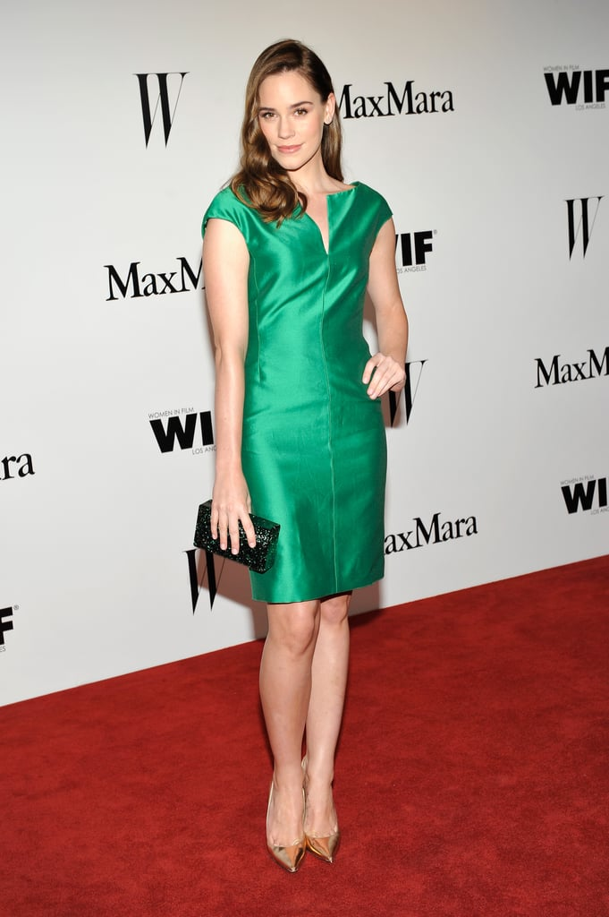 Christa B. Allen celebrated in an emerald-hued Max Mara silk crepe V-neck cocktail dress and pointed-toe pumps.