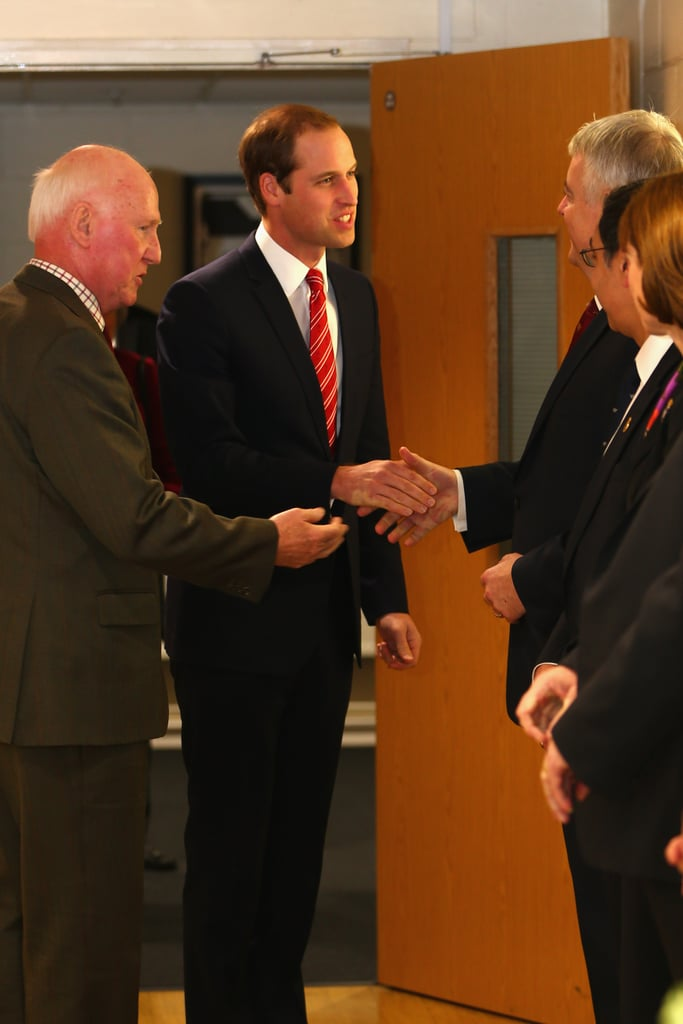 Prince William shakes hands with a guest.