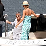 Stacy Keibler and George Clooney boarded a boat.