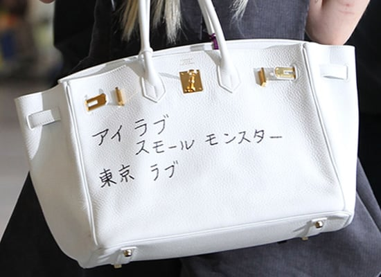 Guess Who is Carrying a White Hermes Bag with Japanese Writing
