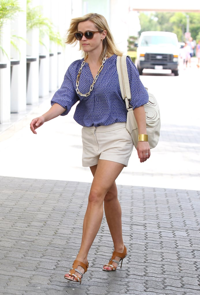 Reese Witherspoon elevated her printed blouse and cuffed shorts via these Pedro Garcia python-print sandals ($248, originally $495).