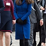 Kate wearing a blue Christopher Kane coat in October 2015.
