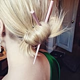 And finished her bun with chopsticks in her hair.