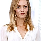 French beauty Vanessa Paradis arrived at Chanel with a casual hairstyle accented with natural makeup that had hints of pink.