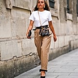 Can't beat the ease of a white tee tucked into trousers. Smart accessories ensure a polished effect.