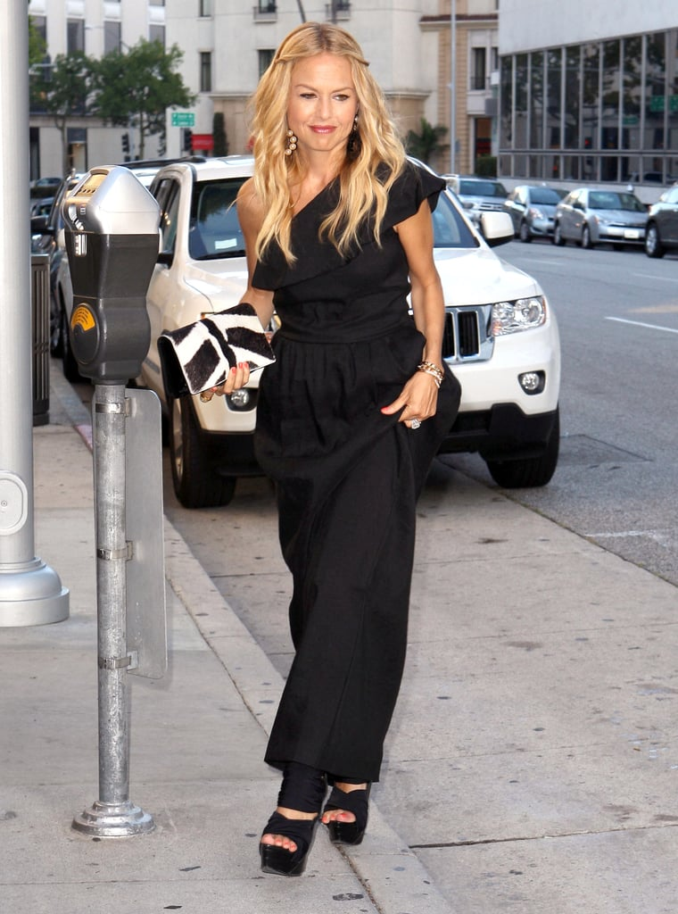 Rachel Zoe in a long black dress.