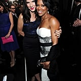 Sandra Bullock and Regina King smiled together.
