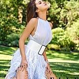 Selena wears an Oscar De La Renta dress, Chanel belt, Chopard ring, and Tiffany & Co bracelet.