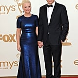 Amy Poehler and Will Arnett hold hands.