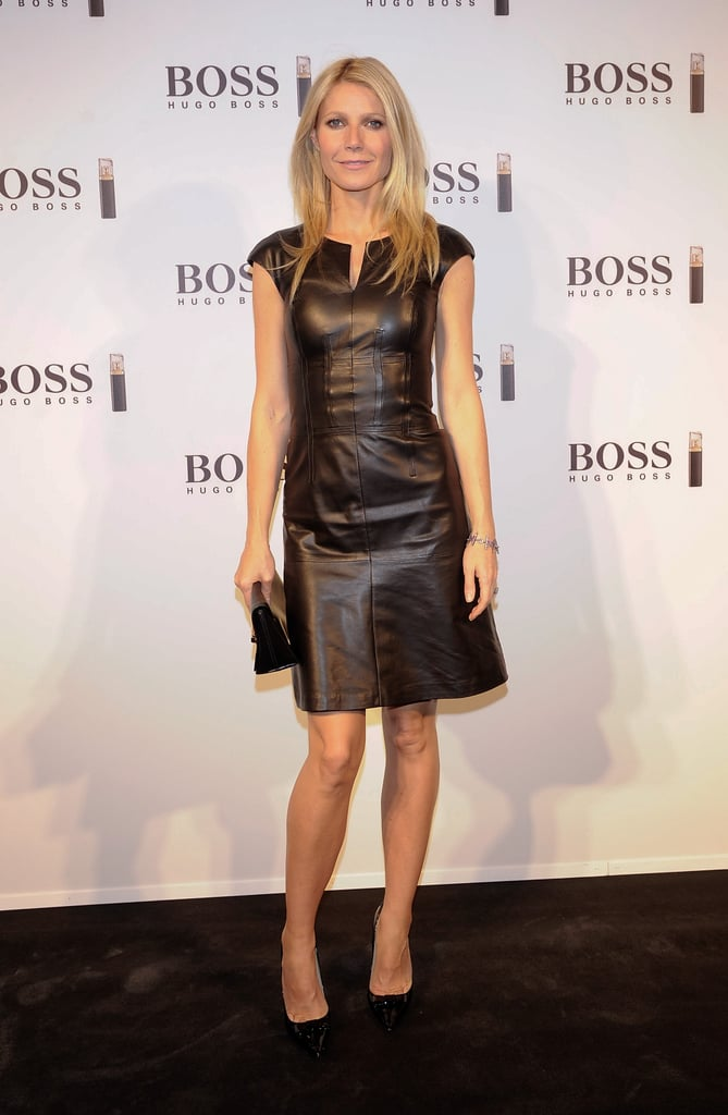 Gwyneth Paltrow took her easy elegance to the red carpet in a BOSS Black by Hugo Boss leather dress and simple black pumps. She kept her hair and makeup laid-back and breezy and her accessories minimal — classic Paltrow!