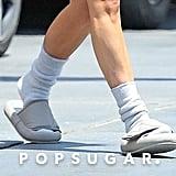 Kim Kardashian Wearing Yeezy Slides and Socks