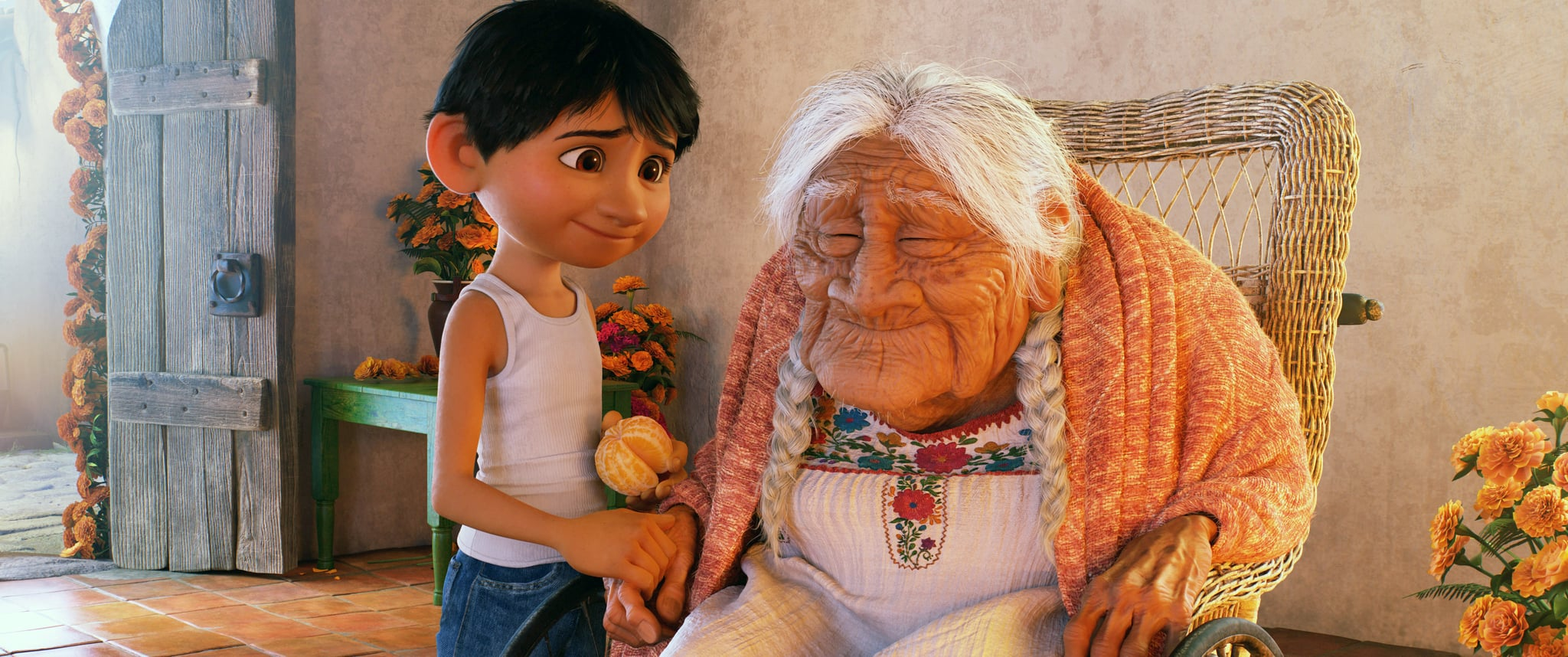 COCO, from left: Miguel (voice: Anthony Gonzalez), Mama Coco (voice: Ana Ofelia Murguia), 2017.  Walt Disney Studios Motion Pictures /Courtesy Everett Collection