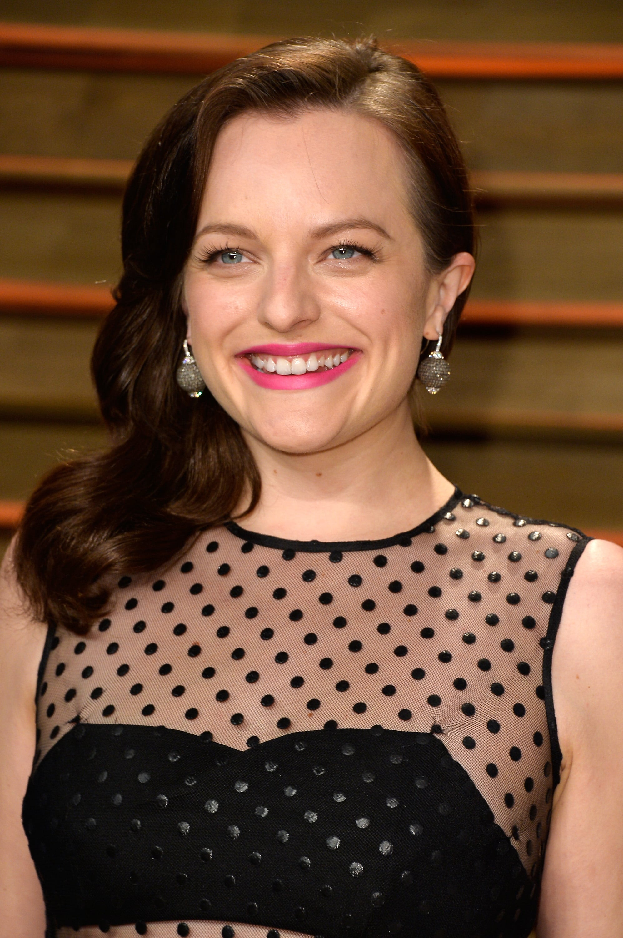 """In 2014, Elisabeth Moss told New York Magazine about her divorce from SNL alum Fred Armisen: """"Looking back, I feel like I was really young, and at the time I didn't think that I was that young. It was extremely traumatic and awful and horrible. At the same time, it turned out for the best. I'm glad that I'm not there. I'm glad that it didn't happen when I was 50. I'm glad I didn't have kids. And I got that out of the way. Hopefully. Like, that's probably not going to happen again."""""""