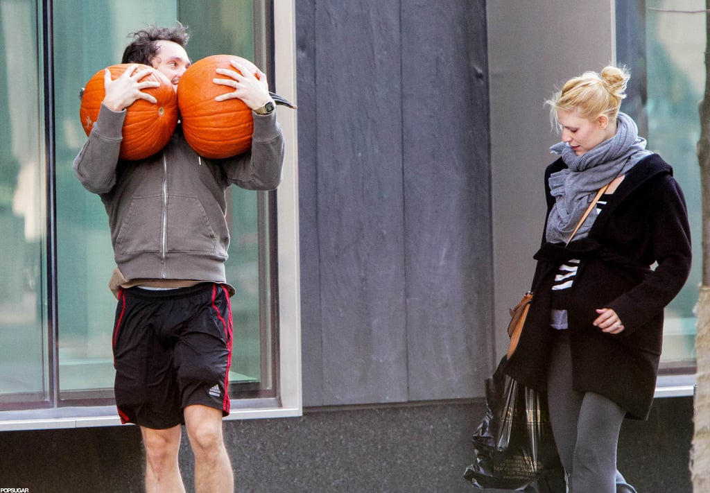 Hugh Dancy carried two pumpkins out of a market in Toronto with Claire Danes.