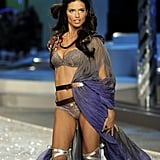 Adriana Lima's 2008 runway look featured Grecian-inspired draping and lace-up heels.