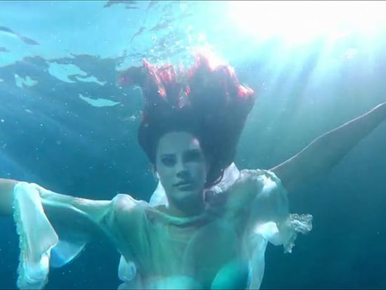 Lana Del Rey Slips Into a Swimsuit for Her Sexy New Music Video