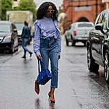 With a ruffled blouse and pumps