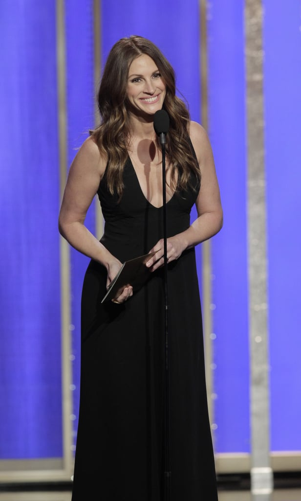 Julia Roberts skipped the red carpet but showed off her mom-of-three body in a black gown with a plunging neckline on the Golden Globes stage.