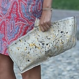 A paint-splattered clutch was a cool counterpoint to a paisley-print pencil. Source: IMAXtree