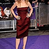 Michelle Pfeiffer stuck with Lanvin in her satin burgundy strapless dress with Sergio Rossi peep toe pumps and Cathy Waterman earrings.