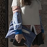We love the mixed-prints effect this clutch had on her blouse.