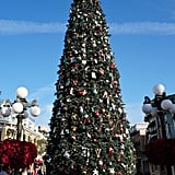 A 60-foot Christmas tree with nearly 1,800 ornaments welcomes park-goers onto Main Street USA.