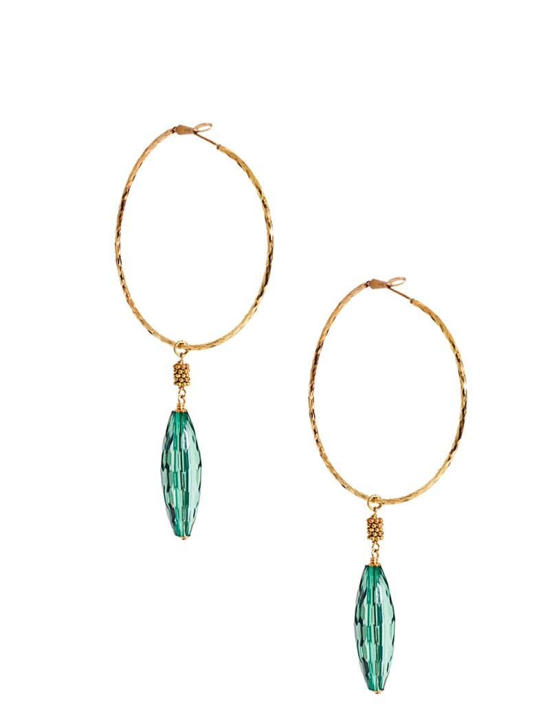Show off these pretty emerald and gold statement earrings with all of the ponytails and hair buns you'll be sporting all season long.  Sam Ubhi Drop Bead Hoop Earrings ($51, originally $182)