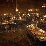 Two rows of candlelit banquet tables at the Red Wedding
