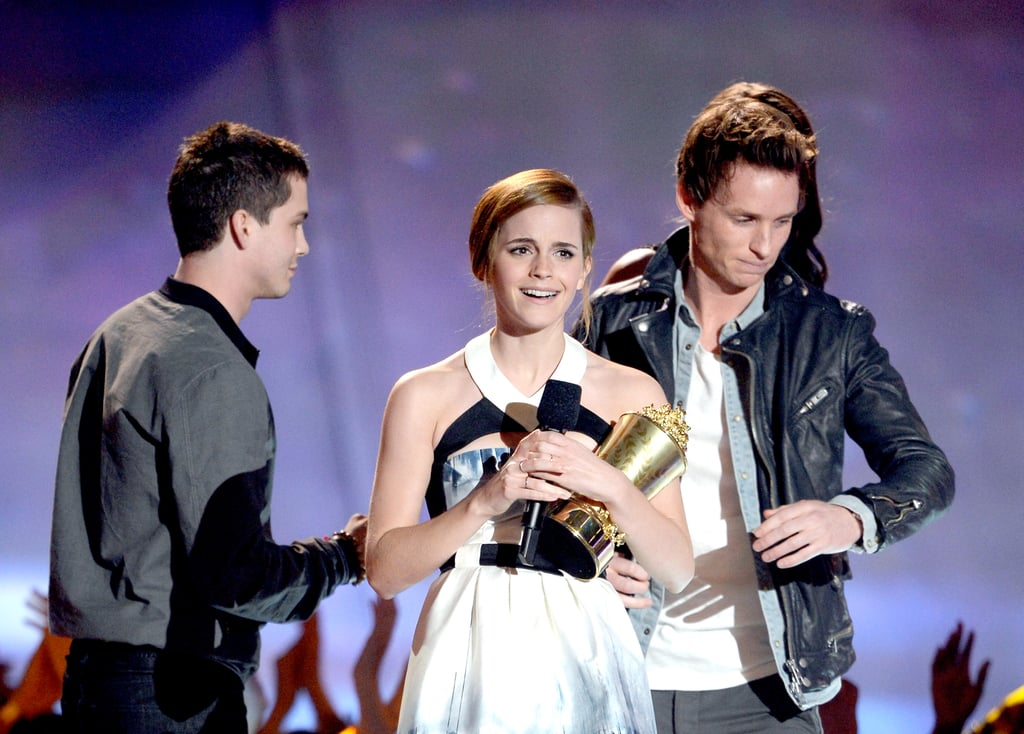 Emma Waston accepted her golden popcorn from Eddie Redmayne and Logan Lerman.
