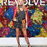 Romee Strijd wearing a dotted tank and camo skirt at the Revolve Festival party.