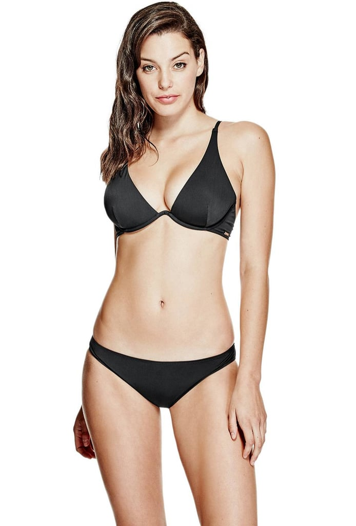 Start with a basic boost from Guess's Underwire Bikini Top ($49), which will add at least one cup size thanks to the padding.