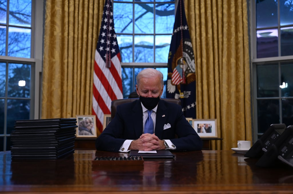 Biden Seated at the Resolute Desk