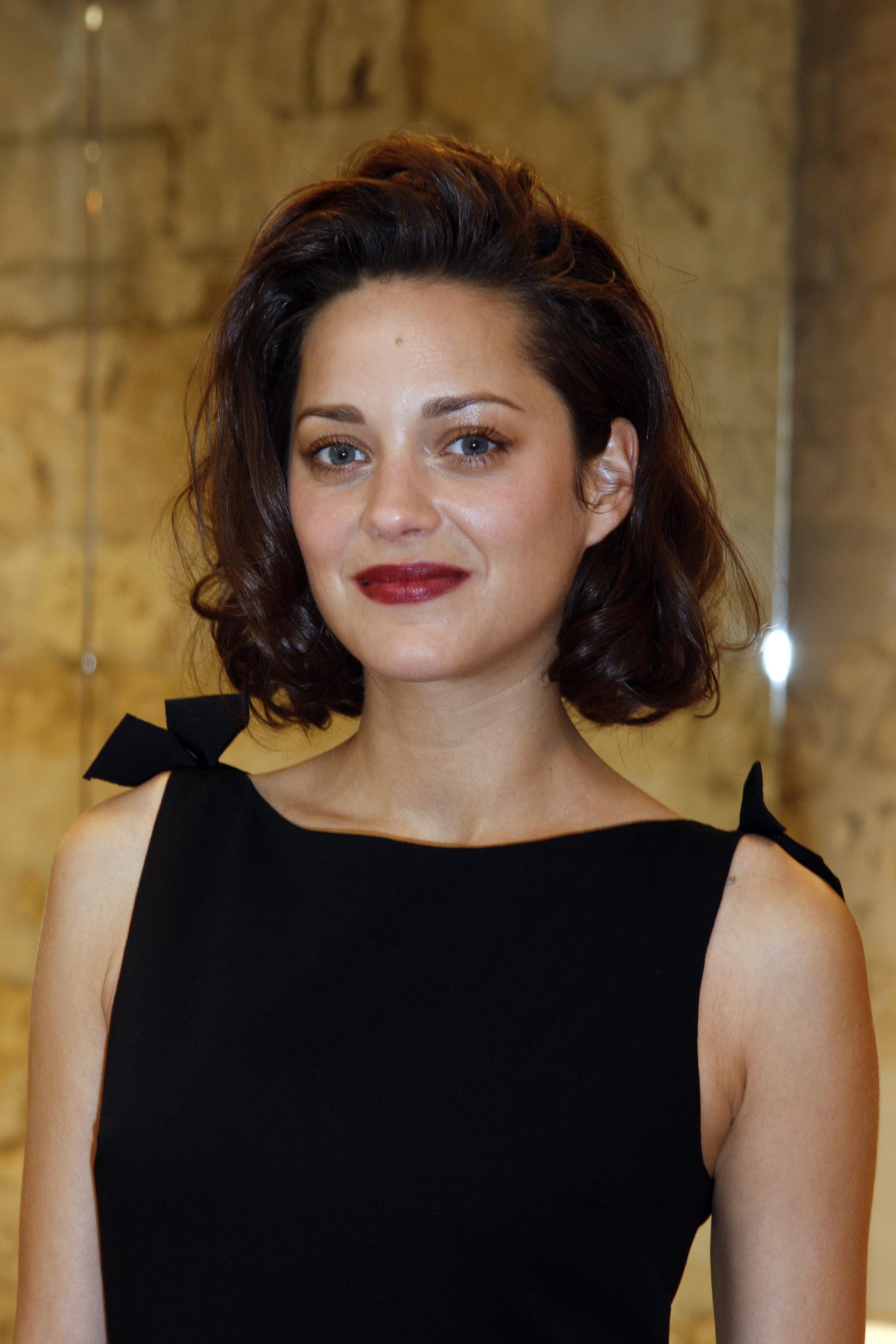 Marion Cotillard Keeps Cool At Dior Couture Show