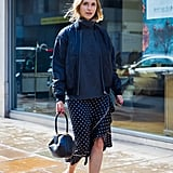 Wear Your Silk Polka-Dot Skirt With Sporty Basics, Like a Bomber Jacket
