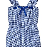 She'll be the prettiest girl at the playground in Baby Gap's blue-and-white-checked gingham romper ($30).