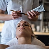 """Will It Be Safe to Get a Facial Again? After your state announces that spas and salons are allowed to reopen their doors, you can expect the facilities near you to up their already-strict and lengthy safety protocols. """"Facial rooms at quality skin-care clinics have always been a safe space,"""" Marino told POPSUGAR. """"Estheticians are required by law to adhere to medical grade sanitizing protocols. We use hospital-strength disinfecting solutions that kill bacteria, fungi, and viruses."""" Because of the nature of the job, this is not only important for customers, but also the skin specialists. """"Generally speaking, facialists are hyper-sensitive to cleanliness,"""" said Marino. """"Not only do we want to protect our clients from all pathogens, but when you work in close proximity to clients all day, you really need to be protecting yourself to ensure your own health and safety.""""  In addition to upping their sanitation measures, many spas are also limiting the number of clients allowed in the office at a given time and encouraging people to regularly sanitize their hands. At Marino's office, they've gotten creative with new disinfectant measures. """"My office has invested in UV lamps that disinfect and kill viruses on all surfaces, so this is one thing we're implementing to take extra care in the rooms between clients and overnight for the entire office,"""" she said. Should You Wear a Mask to Your Facial? Much like dermatology appointments concerning your face, wearing a face covering for the full duration of a facial would be impossible, but that doesn't mean you should leave your mask at home. """"I'm assuming we will all be required to wear masks, and then obviously, the client will have to unmask during the facial, while the facialist remains masked,"""" said Marino.  But clients will only be able to unmask after they've undergone a health check. """"I've seen my colleagues in other states who have been able to reopen taking temperatures before allowing clients in the door,"""" said Marino. """""""