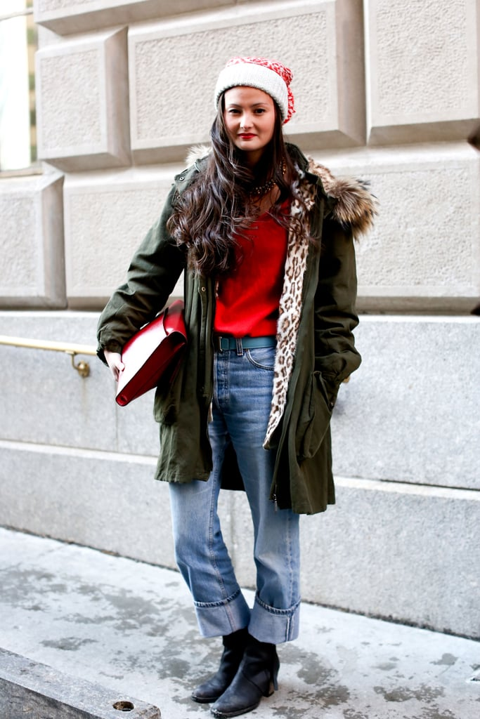 A smart (not cheesy) mix of red and green, laid-back denim, and walkable boots — functional and fashionable.