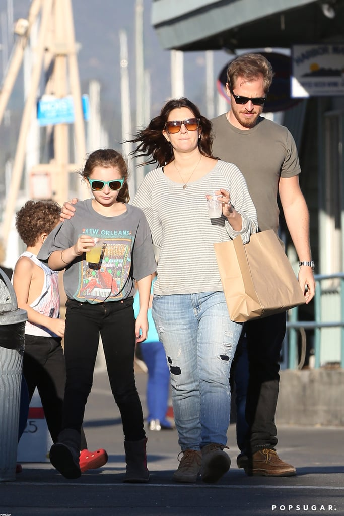 Drew Barrymore and Will Kopelman stepped out in Santa Monica together on Saturday. They went shopping following their first Thanksgiving as a married couple. It was also their 2-month-old daughter Olive's first holiday season celebration after her birth in September. Olive didn't join her parents for their weekend outing, though they did bring a few other young kids along. Drew and Will have been out and about frequently this month, enjoying courtside PDA at the Staples Center and stocking up on groceries. Drew also hit the red carpet for the opening of pal Kimberly Snyder's Glow Bio , which was her second official public appearance since welcoming Olive.