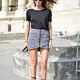 Dress up a simple tee with a chic miniskirt and lace-up sandals.