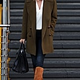 Rosie-Huntington Whiteley's olive coat and suede boots make the outfit.