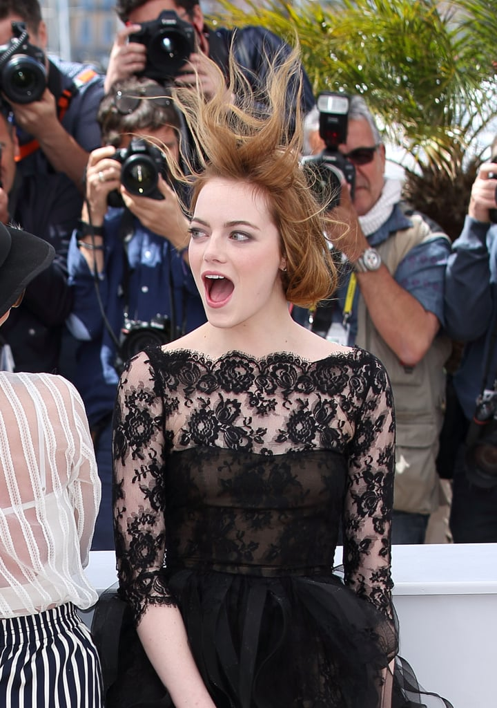 Emma Stone joined Parker Posey and director Woody Allen for a photocall and press conference in support of their film Irrational Man at the Cannes Film Festival on Friday. While posing for the cameras, though, Emma got a little surprise from the windy weather, which threatened to blow up the skirt of her dress and had her gorgeous updo coming undone. The actress handled the gusts with grace and a big smile, making for some seriously fun images. She's one of many stars at Cannes since Charlize Theron and Sean Penn made a dramatic appearance on Thursday and Natalie Portman and her husband stole the show earlier this week. There's plenty more to come from the famed French festival, so check back for the latest!