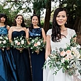 This bride had three bridesmaids standing beside her in various shades of dark blue.