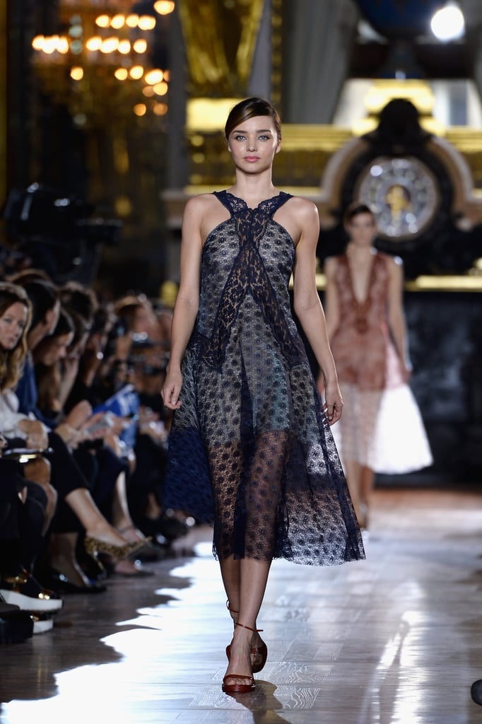 This season, Miranda made a surprise appearance (her first of the season!) in a sheer lace look to open Stella McCartney's Spring 2014 show.