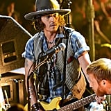 Johnny Depp played guitar on stage at the MTV Movie Awards.