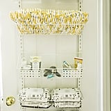 This Easy Move Adjustable Basket Organizer ($50) has high review ratings for good reason. It can be wall-mounted or hung over a door, and can store everything from cleaning supplies to pantry items, and in this case, nursery essentials. I loaded it with diapers, wipes, diaper rash cream, medicine cabinet items, pacifiers, and receiving blankets, and the closet door still closes like a charm.