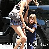 Alessandra Ambrosio helped Anja Mazur into their car.