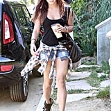 Vanessa Hudgens got grunge in denim cutoffs, a black tank, plaid shirt, and motorcycle boots in LA.