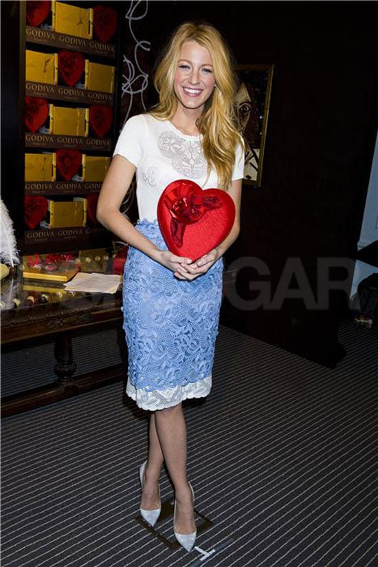 """Blake Lively posed with a heart-shaped box of Godiva chocolates at the launch of the brand's Sweetest Story Ever Told Contest in NYC last night. She wore Valentino for the sweet evening and had her parents, Elaine and Ernie, along for support. Blake's mom, Elaine, was spotted on set with her this week while boyfriend Ryan Reynolds is overseas promoting Safe House. Ryan and Blake will be able to reunite soon, though, since his press tour will take him to the Big Apple in the coming days. Dating was the topic of conversation in a recent Elle interview with Blake, in which she insisted she's """"had four boyfriends in my whole life. I've never been with anyone that's not a boyfriend."""""""
