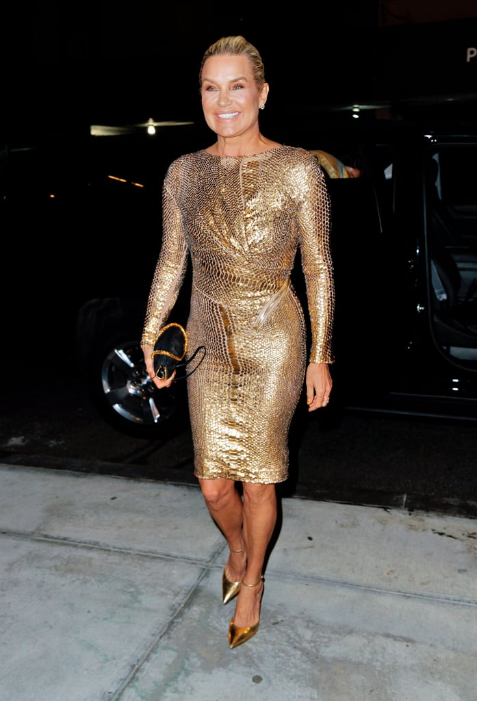 Yolanda Hadid wearing a gold long-sleeved dress and Giuseppe Zanotti heels.